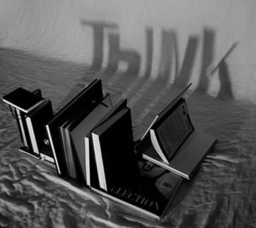 Une typographie réalisée avec les ombres de livres.